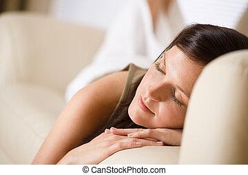 Beautiful woman sleeping on sofa