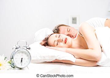 beautiful woman sleeping on the bed - young beautiful woman...