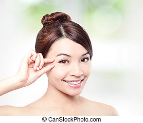 Beautiful woman smile face and finger touch her eyes