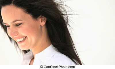 Beautiful woman smiling against a white background