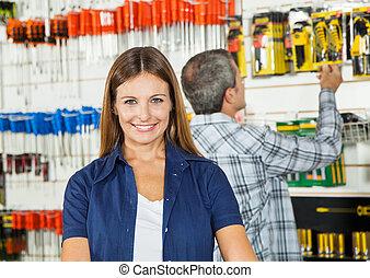 Beautiful Woman Smiling In Hardware Store