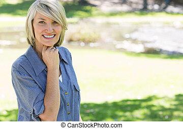Beautiful woman smiling in park