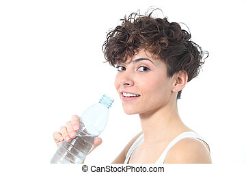 Beautiful woman smiling with a bottle of fresh water
