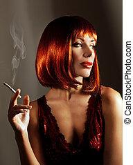 Beautiful woman smoke cigarette