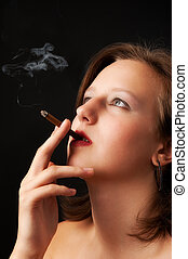 beautiful woman smokes a cigarette