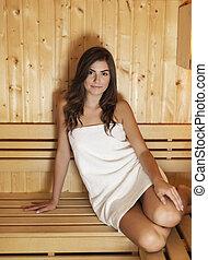 Beautiful woman spending time in sauna