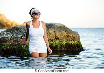 Beautiful woman splashing in the sea