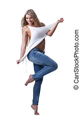 Beautiful woman stand in jeans and tank top