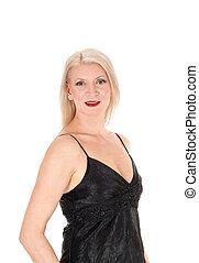 Beautiful woman standing in a black dress