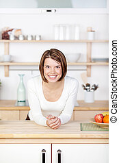 Beautiful woman standing in the kitchen