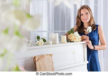 beautiful woman standing near the piano