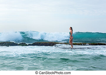 woman standing on a reef