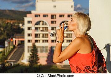 Beautiful woman standing on balcony