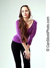 Beautiful woman standing on gray background