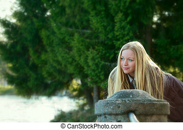 Beautiful Woman Standing on River Bank