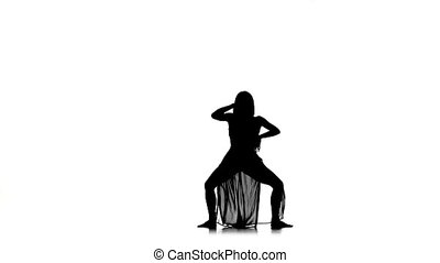 Beautiful woman starts dance modern contemporary style on white, silhouette, slow motion