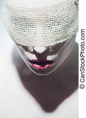 Beautiful woman blindfolded