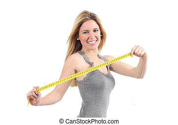 Beautiful woman stretching a measuring tape