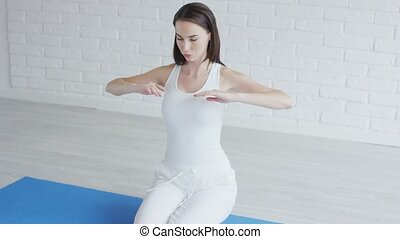 Beautiful woman stretching arms - Attractive young female in...
