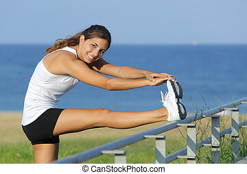 Beautiful woman stretching legs looking at camera