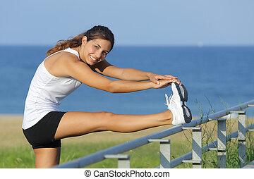 Beautiful woman stretching legs looking at camera