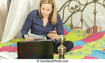 beautiful woman studying on-line at home, uses her...