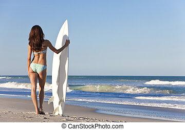 Beautiful Woman Surfer In Bikini With Surfboard At Beach
