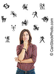 beautiful woman surrounded with zodiac signs thoughtfully lookin