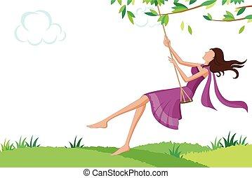 Beautiful woman swinging in park
