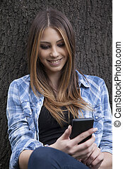 Beautiful woman taking a photo with her smart phone