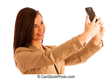 Beautiful woman taking a selfie with smartphone on white background