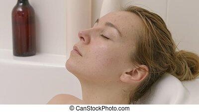 Beautiful woman taking bath. - Beautiful blond woman taking...