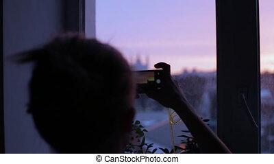 Beautiful woman taking photograph