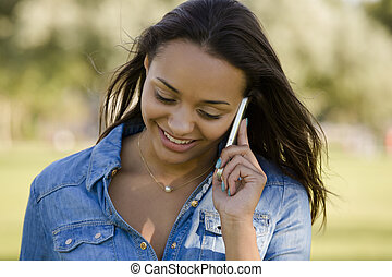 Beautiful woman talking at phone