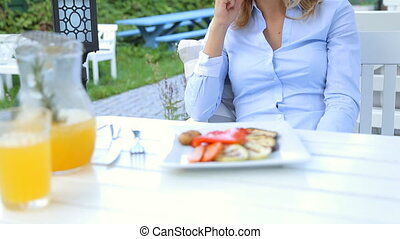 Beautiful woman talking on cellphone in cafe