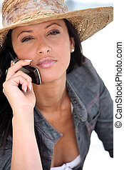 beautiful woman talking on her cell phone