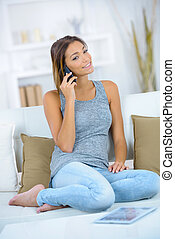 beautiful woman talking on the phone at home