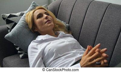 Beautiful woman talking with psychologist