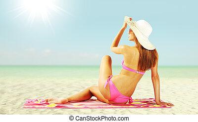 Beautiful woman tans