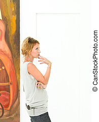 beautiful woman thinking about the artist's message