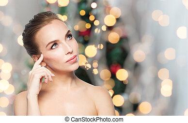 beautiful woman thinking over christmas lights - beauty,...