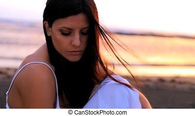 Beautiful woman thinking sunset