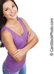Beautiful woman. Top view of beautiful young woman keeping arms crossed while standing isolated on white