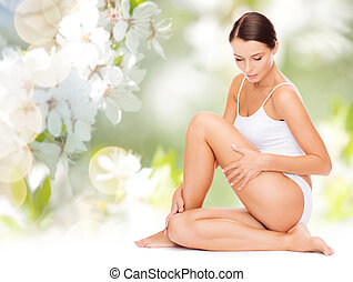 beautiful woman touching her hips - people, beauty and body...