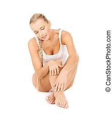beautiful woman touching her legs