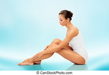 beautiful woman touching her smooth bare legs - beauty,...