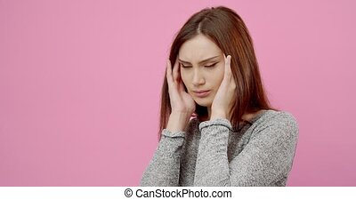 Beautiful woman touching temples because of strong headache