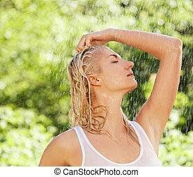 Beautiful woman under rain