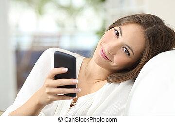 Beautiful woman using a smart phone