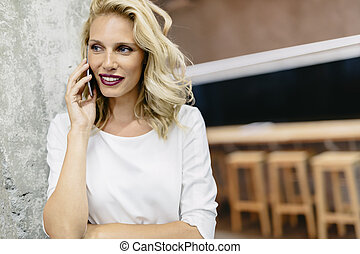 Beautiful woman using cell phone